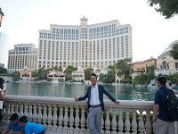 Our dandy boss Mr. Shibuya with gorgeous hotel in Las Vegas in his back.