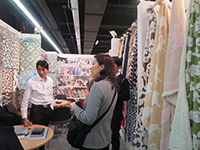Asking about products in each booth.