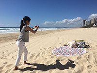 Taking Pictures of Round Beach Towels for our catalogue.