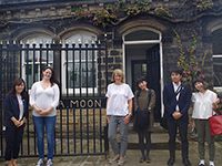 Commemorative picture with the designers from Abraham Moon & Sons Ltd, in front of the historical gate of the office.