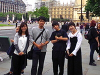 "In front of the great clock known as ""Big Ben."""