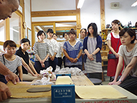 A ceramic art class aimed to inspire imagination. Everyone are listening to the teacher Mr.Nishikawa's explanation.