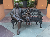 A statue of Roy, brother of Walt Disney, and Minnie.