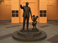 A statue of Walt Disney and Mickey.