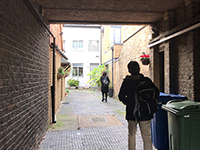 Ahead of the gate there was an office with brick walls and an English Garden.