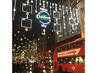The street in London was decorated with christmasn lights.