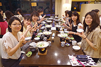 We had a dinner at the hotel. Everyone looks so happy.