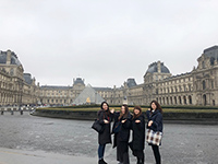 It is a memorial photo on the background of the Louvre Museum.