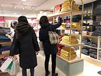 I take a towel and inspect the textile products in Paris.