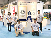 Here's the booth of Tokyo Olympic in 2020. Members here wore the Olympic T-shirt, looking forward for 2020.