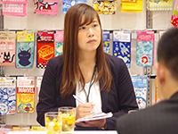 Ms. Takamatsu Chief in a business meeting.