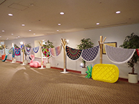 The round beach towels displayed in a spacious booth.