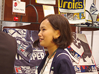 Ms. Oota Chief talking to her customer with charming smile.