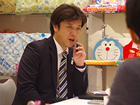 Mr. Tagawa Manager in a meeting seriously.