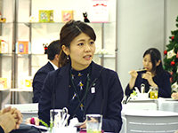 Ms. Watanabe in a business meeting.