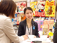 Ms. Takeda chief in business meeting with full of smile.