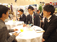 Mr. Okuda chief and Mr. Sakai in a business meeting.