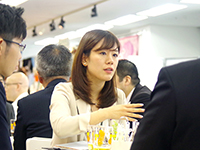 Ms. Kodama manager of Overseas division explaining in serious atmosphere.